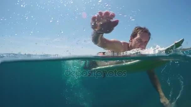 depositphotos 130785354 stock video slow motion underwater smiling surfer